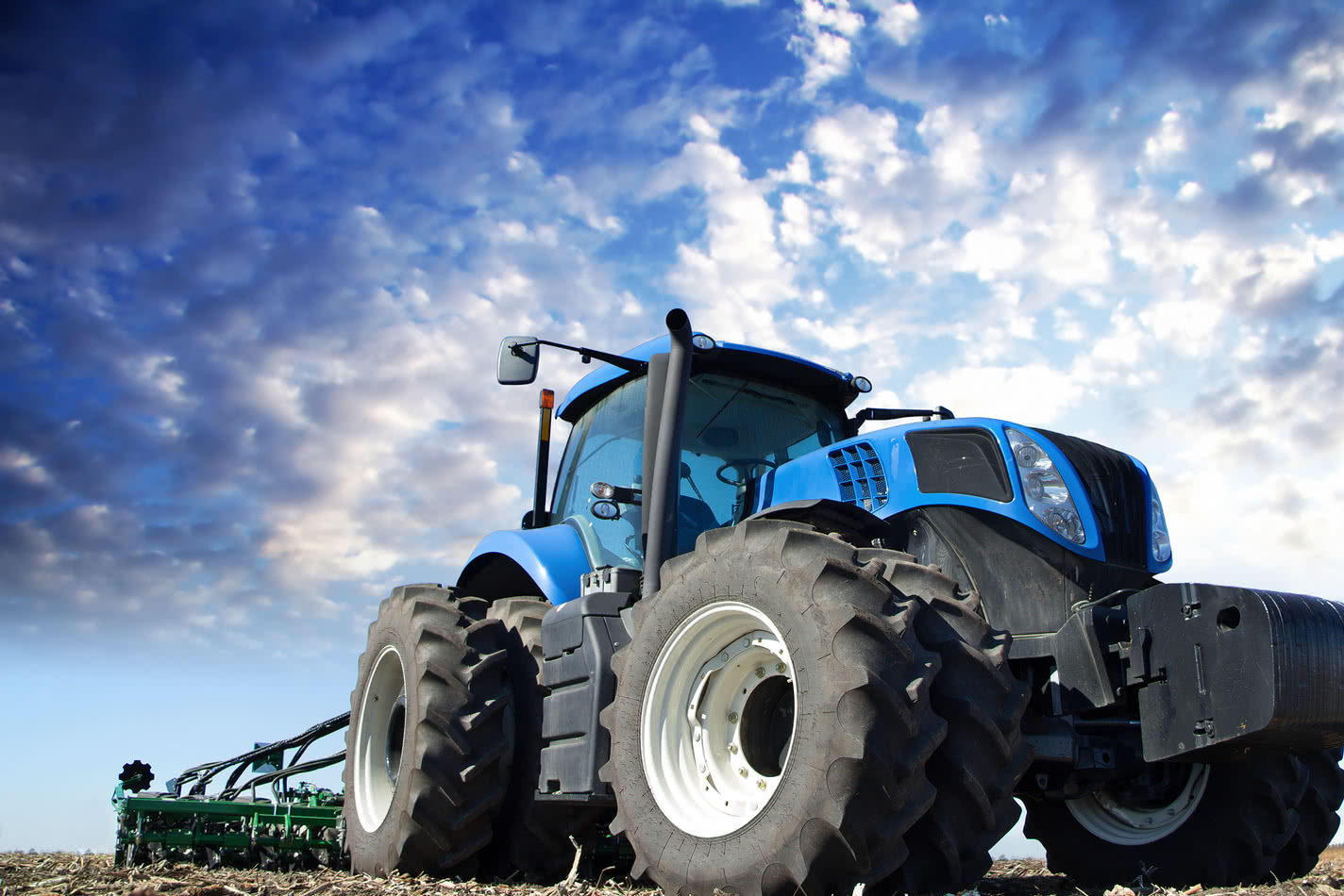 Blue tractor working the field