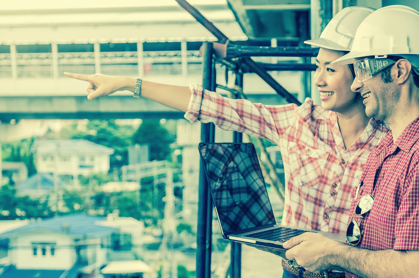 Two construction workers on a build site discussing a working capital loan
