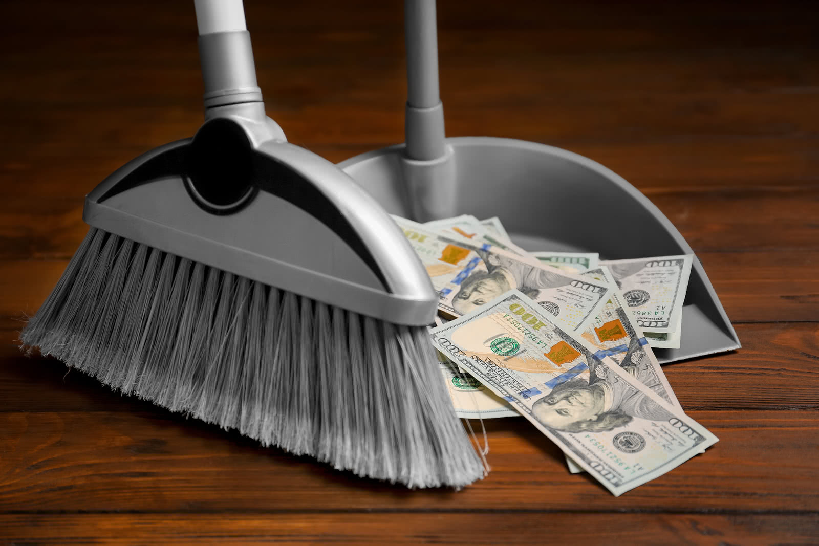 Sweeping dollars into dustpan