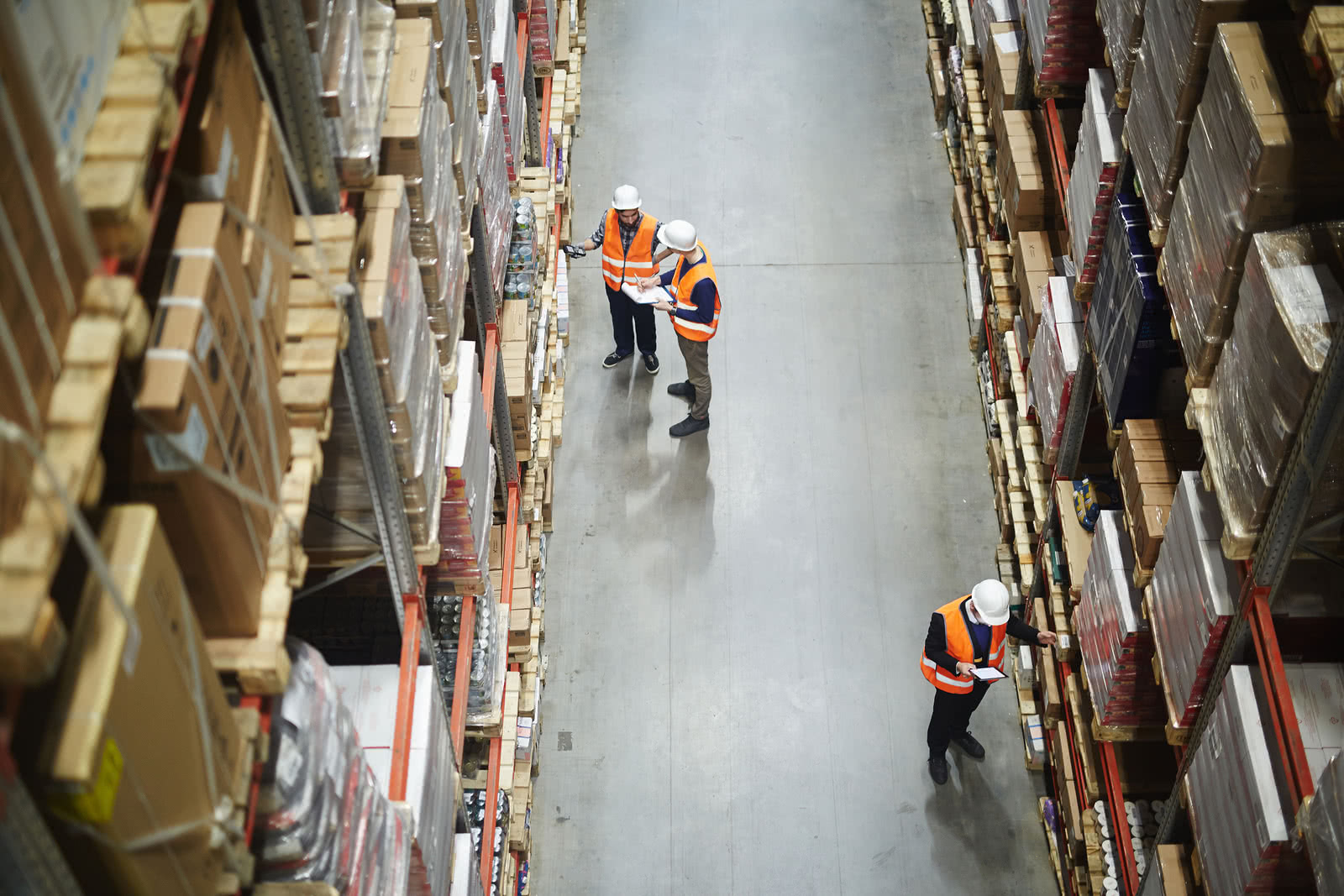 Overhead view of warehouse workers taking stock of their inventory