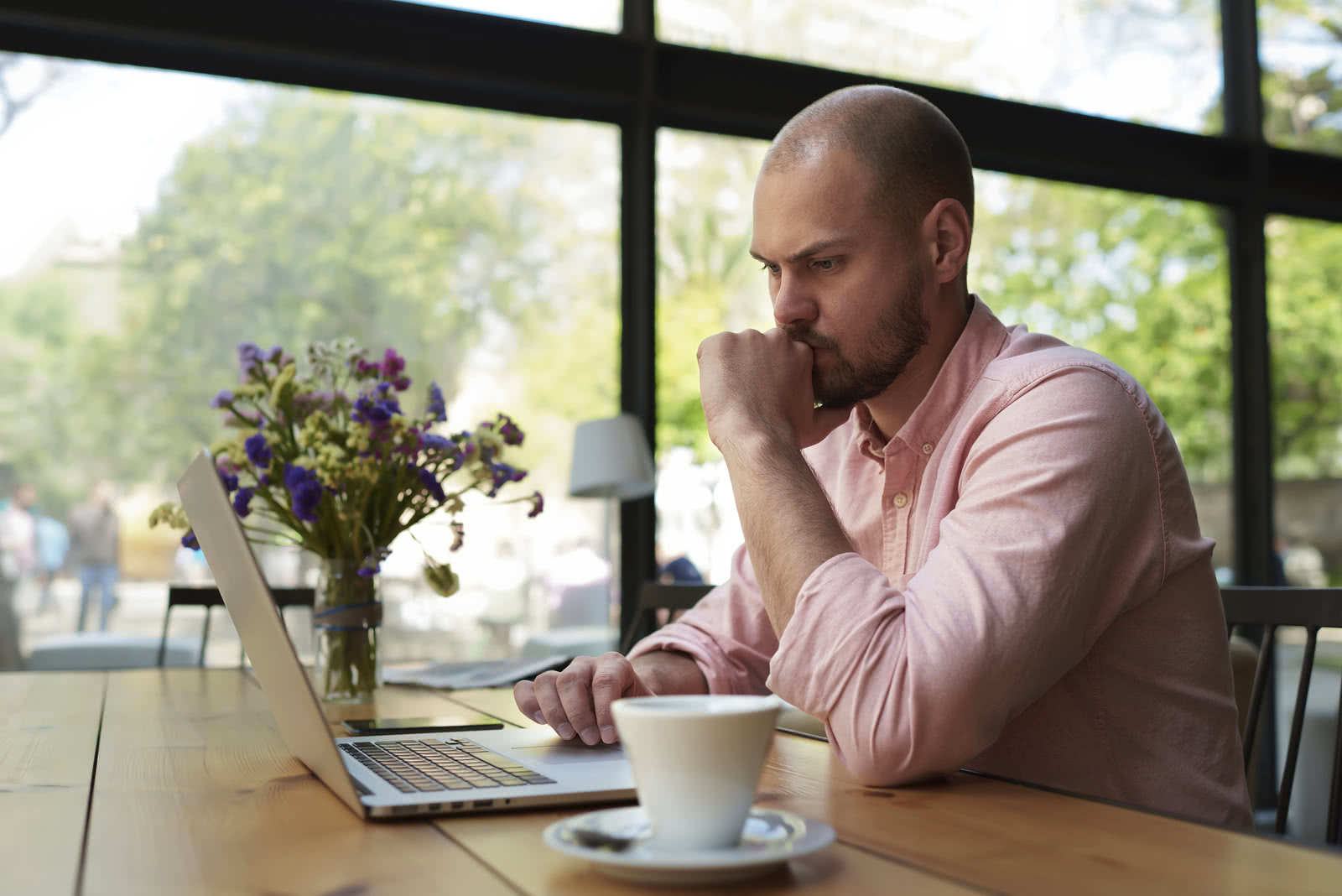 Business owner reviewing financial metrics for small businesses on laptop
