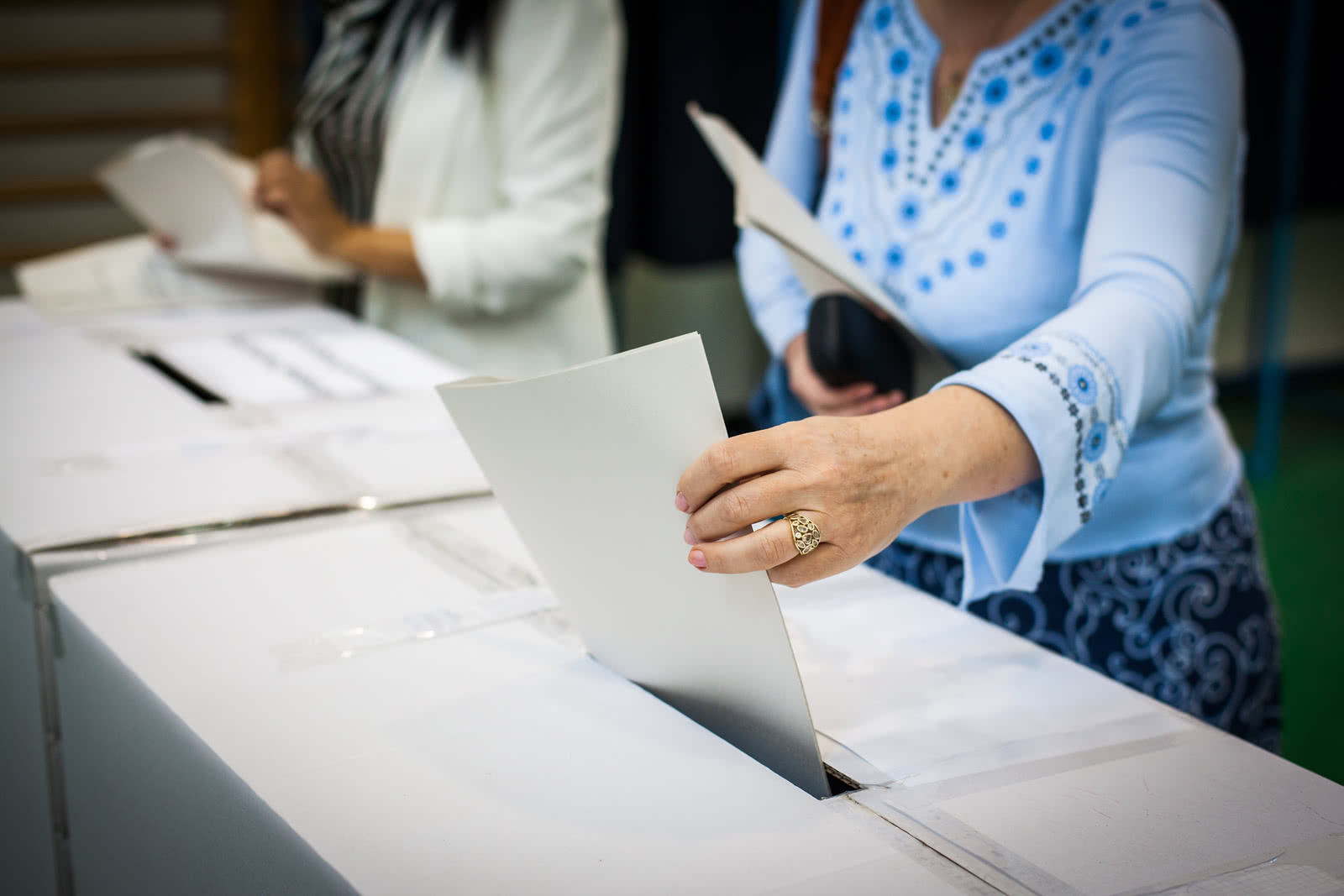 Small business owner casts a ballot in a local election