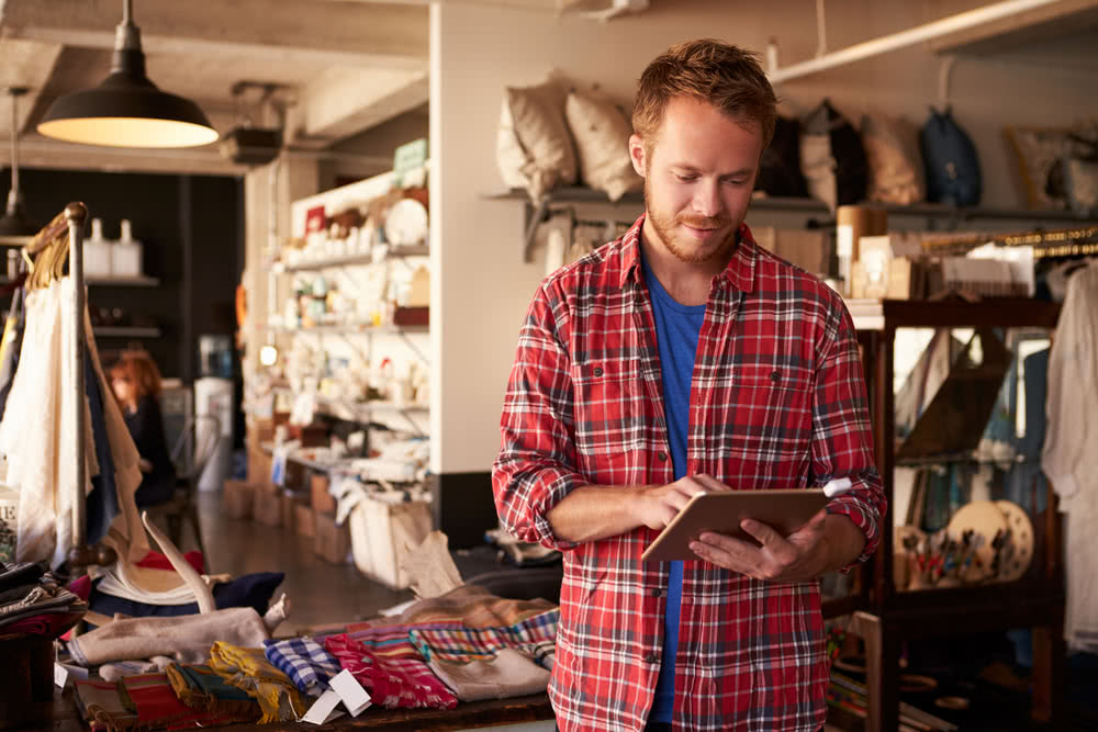 A gift store owner researches new product ideas as a way to grow your business