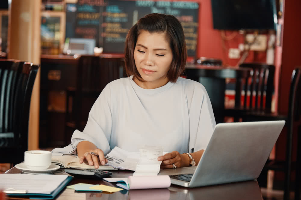 A bar owner calculates her business's profitability, revisiting the importance of financial wellness