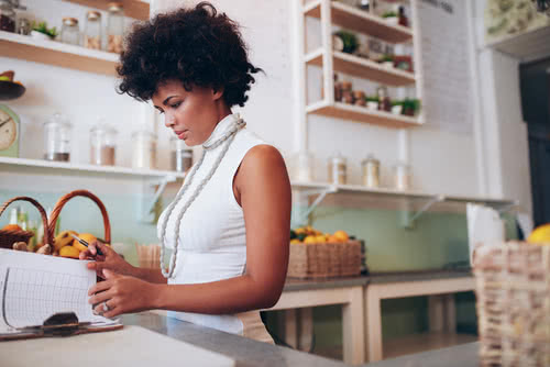 Retail business owner reviews how to pay small business taxes