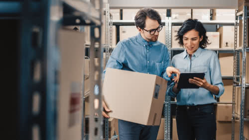 Business owner trains a new hire on storing inventory properly