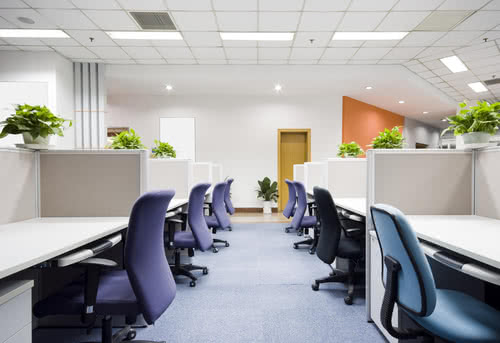 Empty desks and chairs signify many employees out sick
