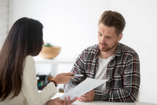Two business owners review loan paperwork together