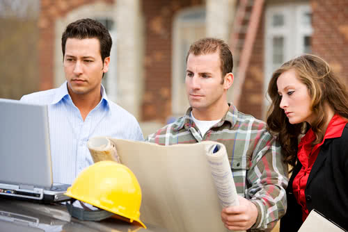 A small construction company team updates their business plan