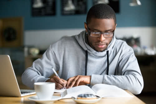 Young male business owner takes courses for small business owners