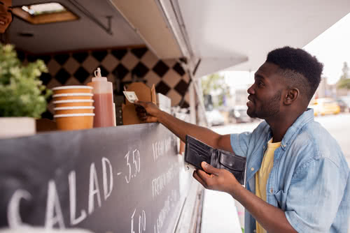 Man pays for food and wonders do businesses have to accept cash