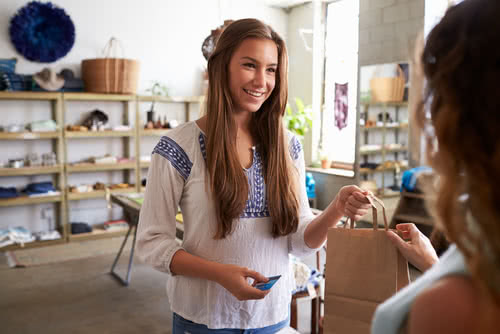 Customer attends boutique event, a marketing idea for small businesses