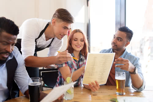 Cafe owner follows tips for restaurant owners by chatting with customers
