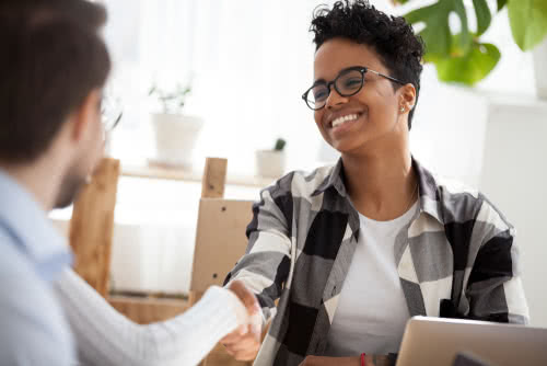 Smiling employer avoids illegal interview questions with an applicant