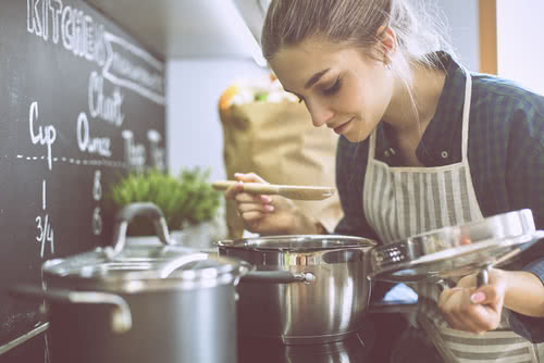 Female chef pays for kitchen equipment with tax deductions for restaurant owners