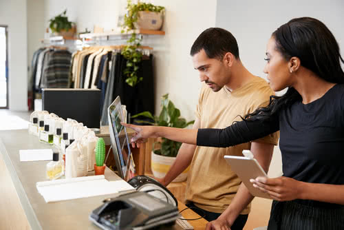 Man and woman work in a retail store, one of the fastest-growing industries