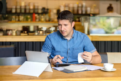 Male restaurant owner learning basic accounting terms