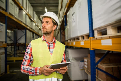 Owner chooses a supplier for his business by touring their inventory warehouse