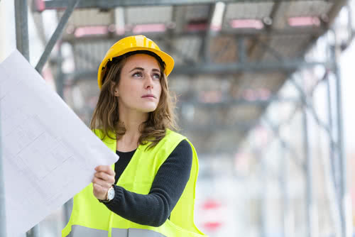 Female construction business owner thinking about what is seasonal working capital