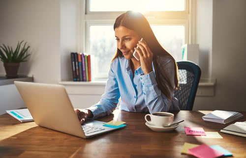 Woman works from home for employee well-being