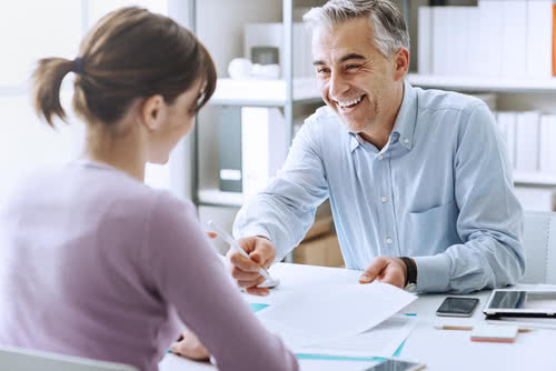 Small business owner meets with consultant to prepare for a recession