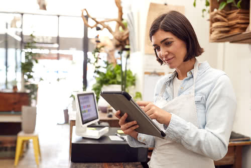 Florist with tablet considers debt vs equity financing