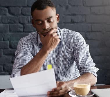 A business owner considers whether they should use a business investor or loan