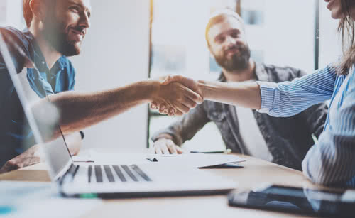Business partnership handshake concept.Photo two coworkers handshaking process.Successful deal after great meeting.Horizontal, blurred background