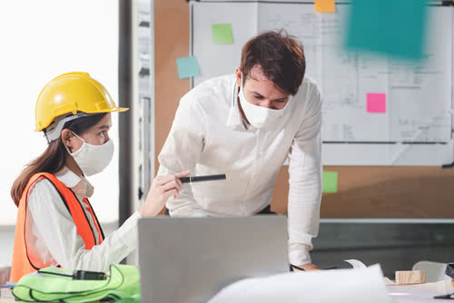 Two construction industry employees discussing how they